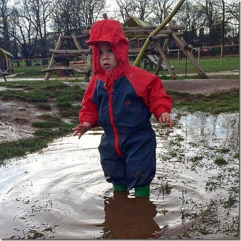 Archie puddle jumping in his Togz suit