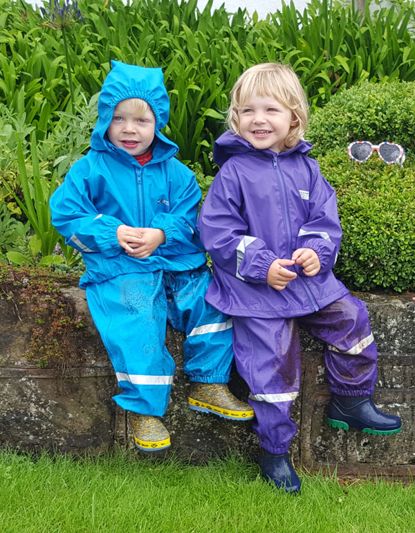 Archie and Connie well wrapped up for outdoor play in their Ocean Rainwear waterproof 2 piece suits of jacket and dungarees