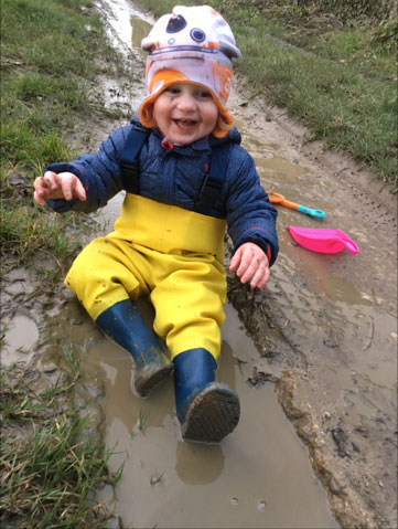 Archie age 2, loves his waders, loves mud!