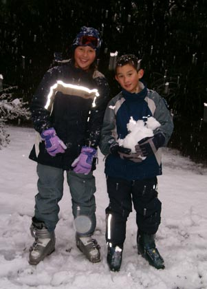 Elisha and Dominic enjoying the New Zealand Snow in Dare2Be jacket & salopettes