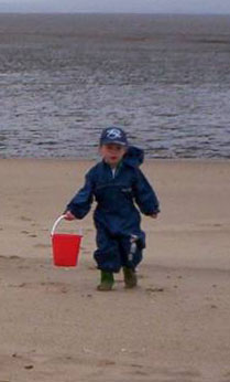 Elliott playing on the beach in our lovely British summer weather!