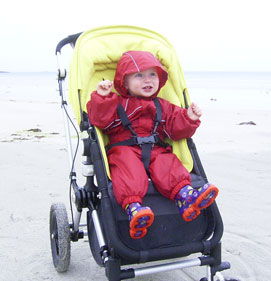 Ethan snug on a chilly beach in Regatta Puddle Suit