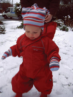 Grace Mae discovering snow in Regatta Puddle Suit