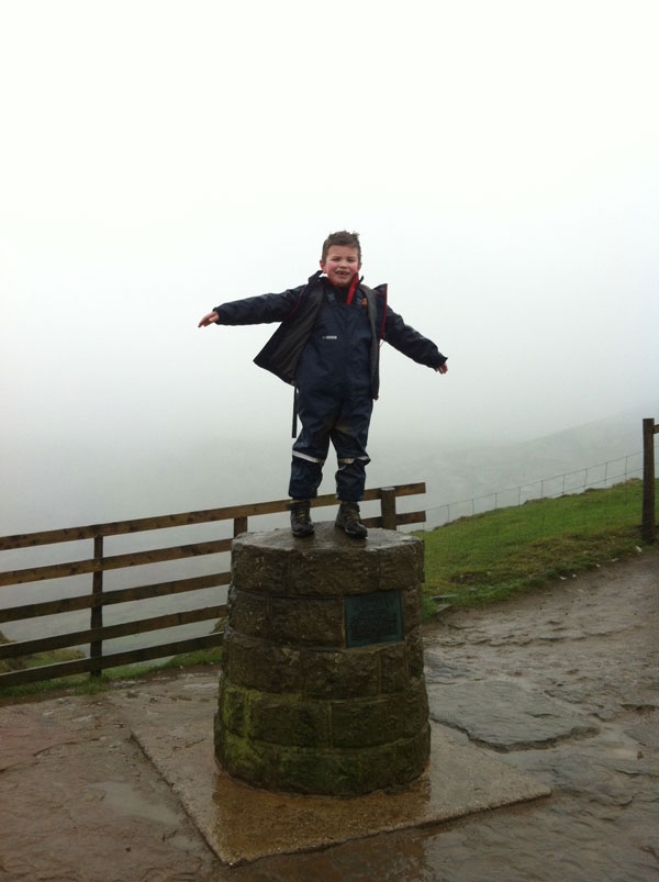 Gregor on his first mountain walk, snug in Ocean Rainwear Dungarees