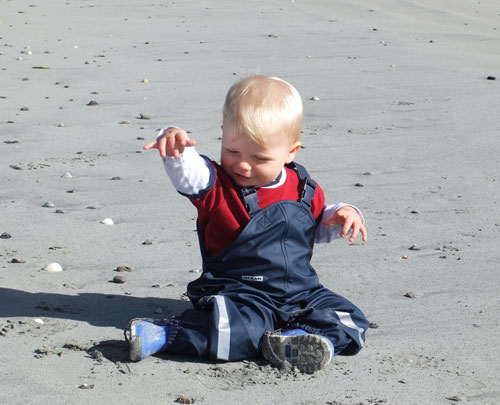 Harvey on the beach in his Ocean Dungarees