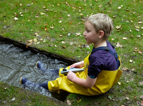 Sandy having fun in kids waders