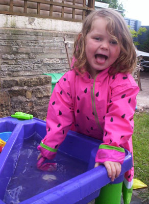 Jessica F having fun in her Wippette Kids Watermeon raincoat