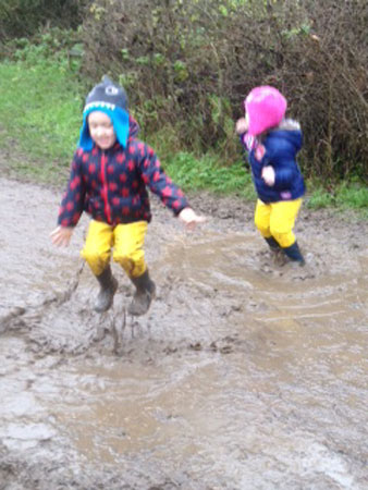 Karen's children having fun in waders