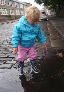 Kasia's little girl in Playshoes Navy Dots wellies