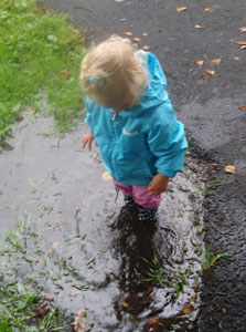 Puddle Jumping in Playshoes Navy Dots wellies