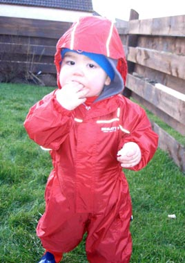 Leo 'feeding the birds' in his regatta Puddle Suit