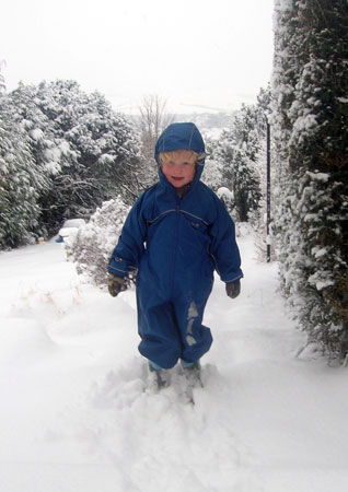 Luca in Puddle suit in snow