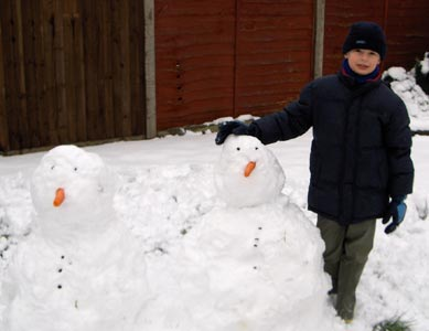 Max proudle showing off the snowmen