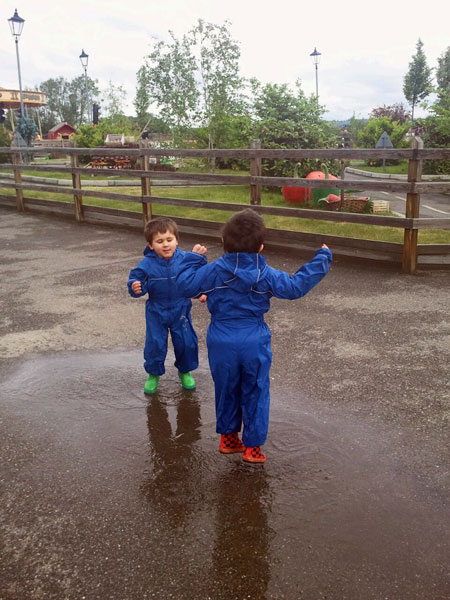 Micah & Eben having fun in puddles