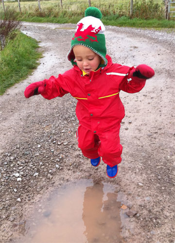 Owen's son puddle jumping in his Kiba suit and Snowstopper mitts