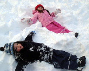 Snow angel twins in Kiba dungarees