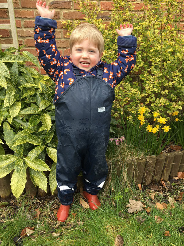Sam's son, really happy in his new Ocean Rainwear dungarees!