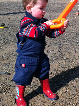 Thomas B in Warm and Dry dungarees playing on the beach