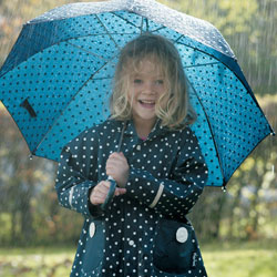 Matching navy spotty coat and umbrella from Playshoes