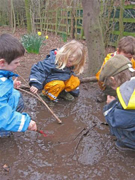 sticks...mud.... Waterproof World clothing.... fantastic Forest School play!